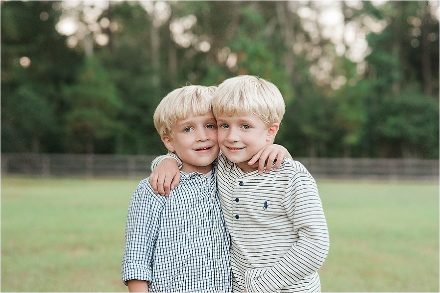 CHILDHOOD LEUKEMIA boy with ALL hugging brother photo by The Gold Hope Project